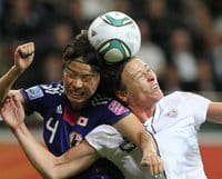 Saki Kumagai clashes with USA\'s Abby Wambach in the World Cup final in Frankfurt last Sunday