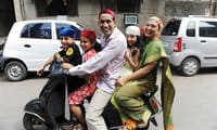 An Indian Zoroastrian or Parsi family leave a fire temple after offering prayers on Parsi New Year \'Navroze\' in Mumbai
