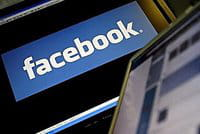The logo of social networking website \'Facebook\' is displayed on a computer screen.