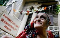 An Indian Parsi woman comes out of a Fire Temple after offering prayers on the occaision of Navroz, or Parsi New Year